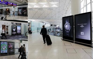 香港机场出发贵宾室附近电子刷屏广告