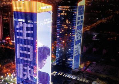 苏州张家港汇金中心地标广告-苏州汇金中心楼体灯光秀广告